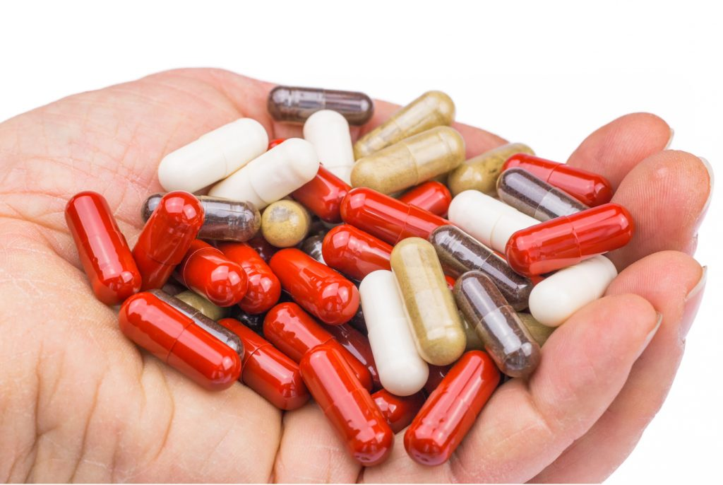 Variety of Supplements in Hand
